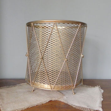 Vintage gold metal Hollywood Regency waste paper basket trash can with ball feet