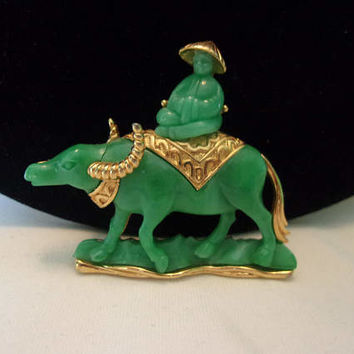 HATTIE CARNEGIE Vintage Asian Man on Water Buffalo Oxen Brooch Rhinestone Faux Jade Lucite Figural Pin