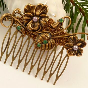 Antique hair comb in bronze with flowers and leafs
