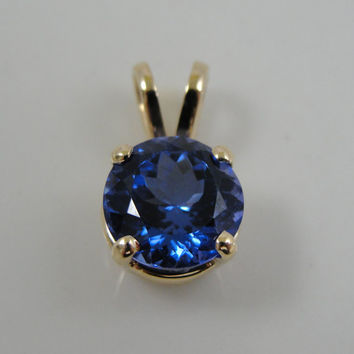 Large Tanzanite Solitaire Pendant in Fine Gold PDTZ130P
