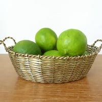 Oval woven brass basket with handles