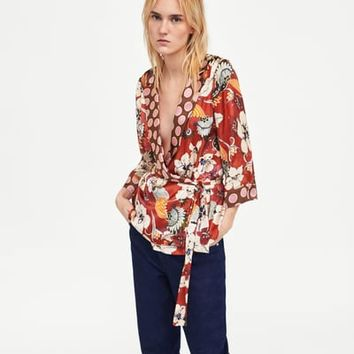WRAP BLOUSE WITH CONTRASTING PRINT