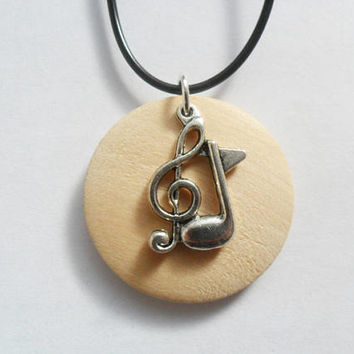 "Wooden disc pendant necklace with silver treble clef music note charm that is adjustable from 17"" to 19"""