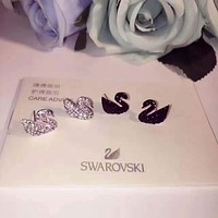 SWAROVSKI  Precious and delicate black swan earrings, simple but elegant