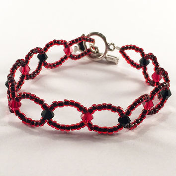 Blood Candi bracelet .. Two-strand black and red seed bead and black and red bicone bead bracelet with a Tibetan silver Tulip toggle clasp
