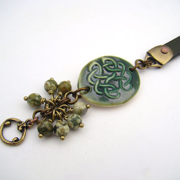 Green Celtic bracelet, ceramic leather mixed metal copper brass rhyolite, 7 3/4 inches 20cm