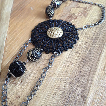 Large black and gold flower pendant embelished with gunmetal chain and black and gold beads-Necklace