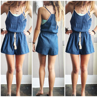 A Denim Romper With Crochet Detail
