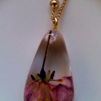 """Real pink plum flower in clear resin teardrop shaped pendant with 24"""" goldtone chain"""