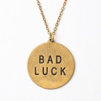 GOLD BAD LUCK PENDANT NECKLACE