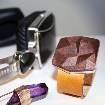 genuine vegetable-tanned leather + metal + premium hardwoods