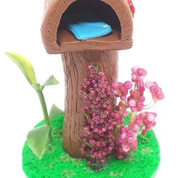 Miniature fairy garden mailbox. With pink flowers and ladybug.