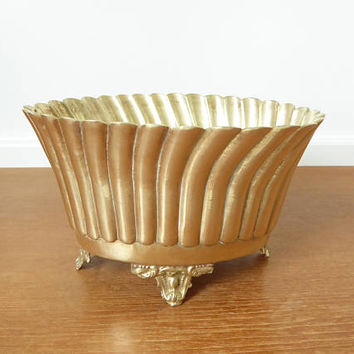 Oval footed brass planter or cachepot with fluted sided and scalloped rim