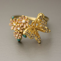 Butterfly with tiny flower decoration ring