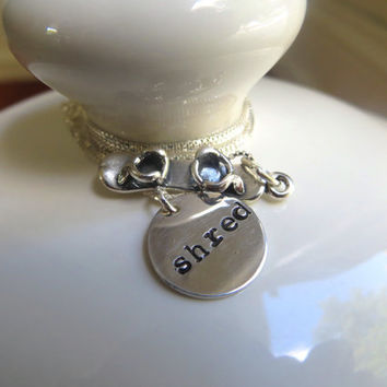 "Silver snowboard necklace with sterling silver hand stamped ""shred"" charm and silver snowboard charm"