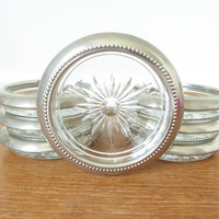 Seven silverplate and glass coasters by Leonard and W S Blackinton