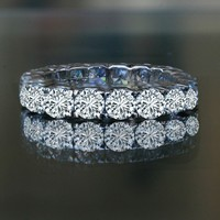 7CT TW (5 MM) ROUND PRONG SET ALL AROUND CLASSIC ETERNITY BAND.