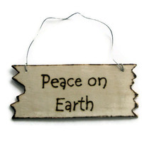 Wood Christmas ornaments. Rustic Christmas decorations. Peace on Earth.