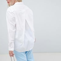 ASOS DESIGN Curve boyfriend shirt with pleat detail back in stretch cotton at asos.com