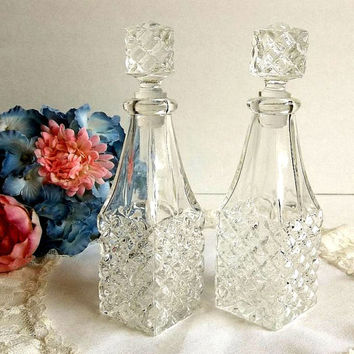 Vintage pair of diamond point cruets, faceted cut glass oil and vinegar cruets set with stoppers