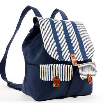 Blue backpack with  white stripes flap. Cotton backpack. Denim backpack.