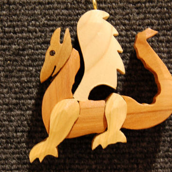DRAGON CHRISTMAS ORNAMENT Wood Carving.  Whimsical yet festive, a miniature work of art.