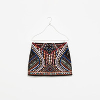 MINI SKIRT WITH BEADS