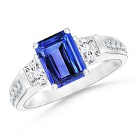 Emerald Cut Tanzanite and Trapezoid Diamond Three Stone Cathedral Ring