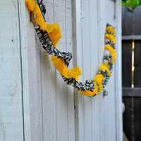 Crepe garland / streamer for party or birthday - yellow, black & white polka dot