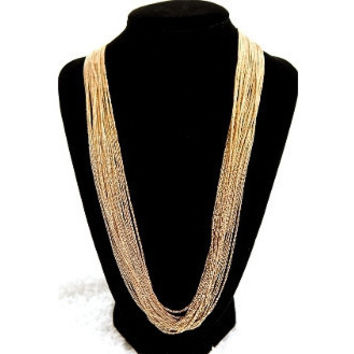 Gold Long Strand Necklace