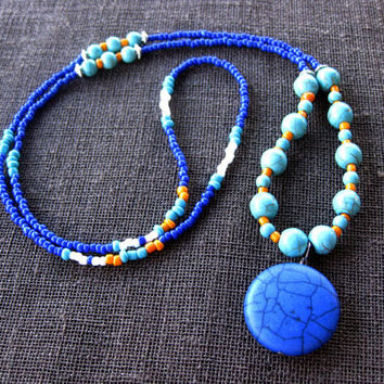 Long Seed Beaded Necklace with Dark Blue Flat Round Shaped Howlite Stone