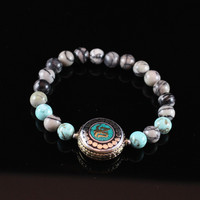 Tibetan Silver Om Bracelet with Turquoise Magnesite and Black Silk Stone Beads