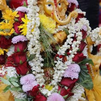 Statue of the Hindu God Ganesh with Garlands, Paris, France, Europe