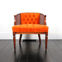 Orange + Cane. Vintage Tufted Side Chair with Cane Sides..