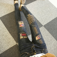 Fashion Personality Pattern Patch Irregular Worn Beggar Long Jeans Small Foot Pants