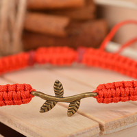 Handmade designer thin woven red bracelet made of silk threads with twig