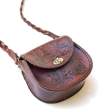 Vintage 1970s small chestnut leather shoulder bag with intricate floral tooling and saddle stitched edging