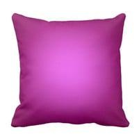White spotlight on pink cushion