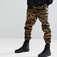 Puma x XO Joggers In Camo 57534951 at asos.com