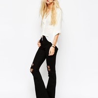 ASOS Bell Flare Jeans In Clean Black With Thigh Rips