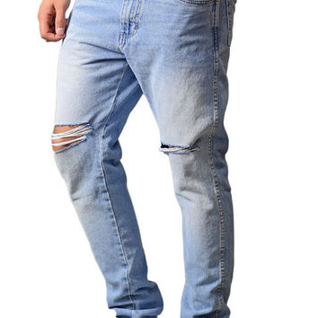 The Tapered Ripped Denim Jeans in Faded Indigo