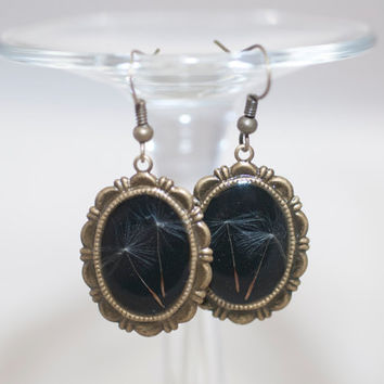 Bronze earrings with dandelion covered with epoxy resin jewelry