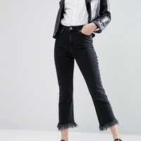 ASOS Cropped Flare Jeans in Washed Black with Arched Raw Hem at asos.com