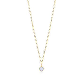 Tiffany & Co. - Paloma Picasso® blue chalcedony dot charm in 18k gold on a round link chain.