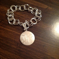 Sterling Silver Monogrammed chained bracelet.
