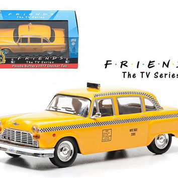 Friends (TV Series) Phoebe Buffay's 1977 Checker Taxi Cab 1-43 Diecast Car Model by Greenlight