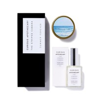 The Striped Cabana Perfume and Candle Tin Gift Set by Curious Apothecary.  Island white floral, adrift summer clouds