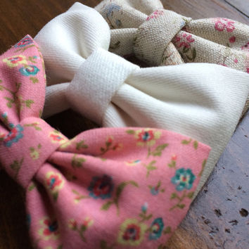 Linen floral, winter white, and new pink floral hair bows from Seaside Sparrow. These hair bows make a perfect gift for her.