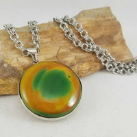 Agate gemstone pendant necklace, green and yellow jewelry, large round pendant, body novelties, Rastafari style