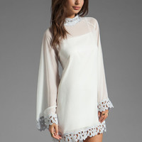 AGAIN Little Edie Parisian Laced Chiffon Bell Sleeve Dress in White Lavender from REVOLVEclothing.com